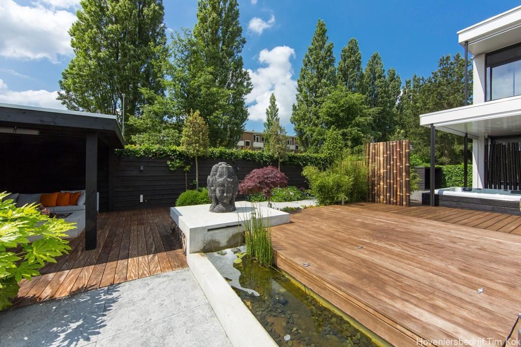 369 aziatische sfeer loungehoek vlonder buitenparket hardhouten vlonder zonneterras bamboehaag - Opslag terras ...
