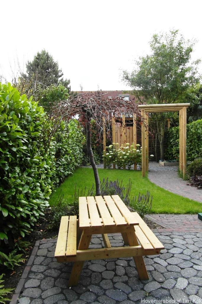Kindvriendelijke achtertuin rotterdam hoveniersbedrijf for Bestrating kleine tuin