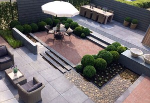 Niveauverschil tuin moderne tuin ondiepe vijver buxuswolken